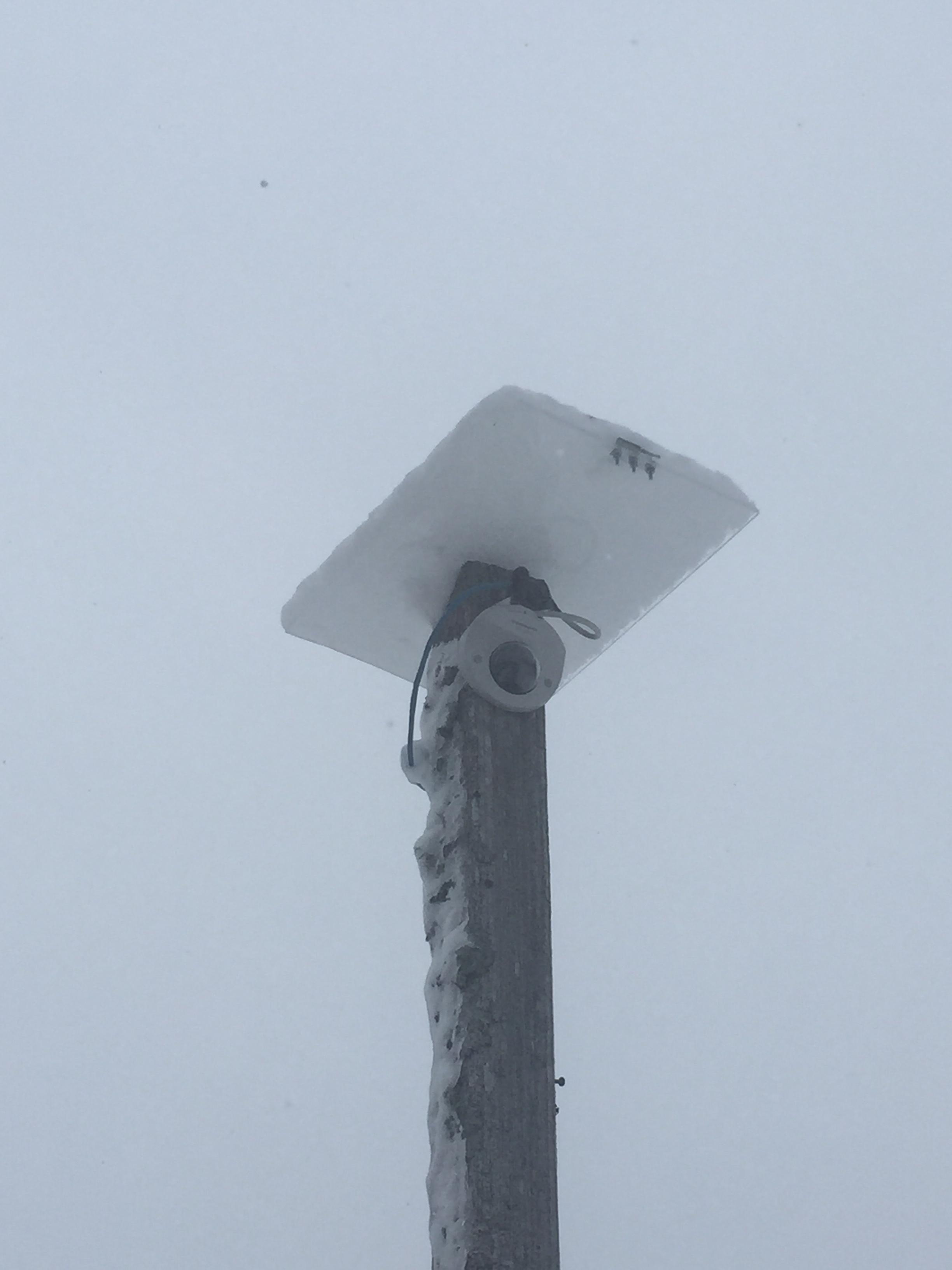 Ski lodge camera under solar panel