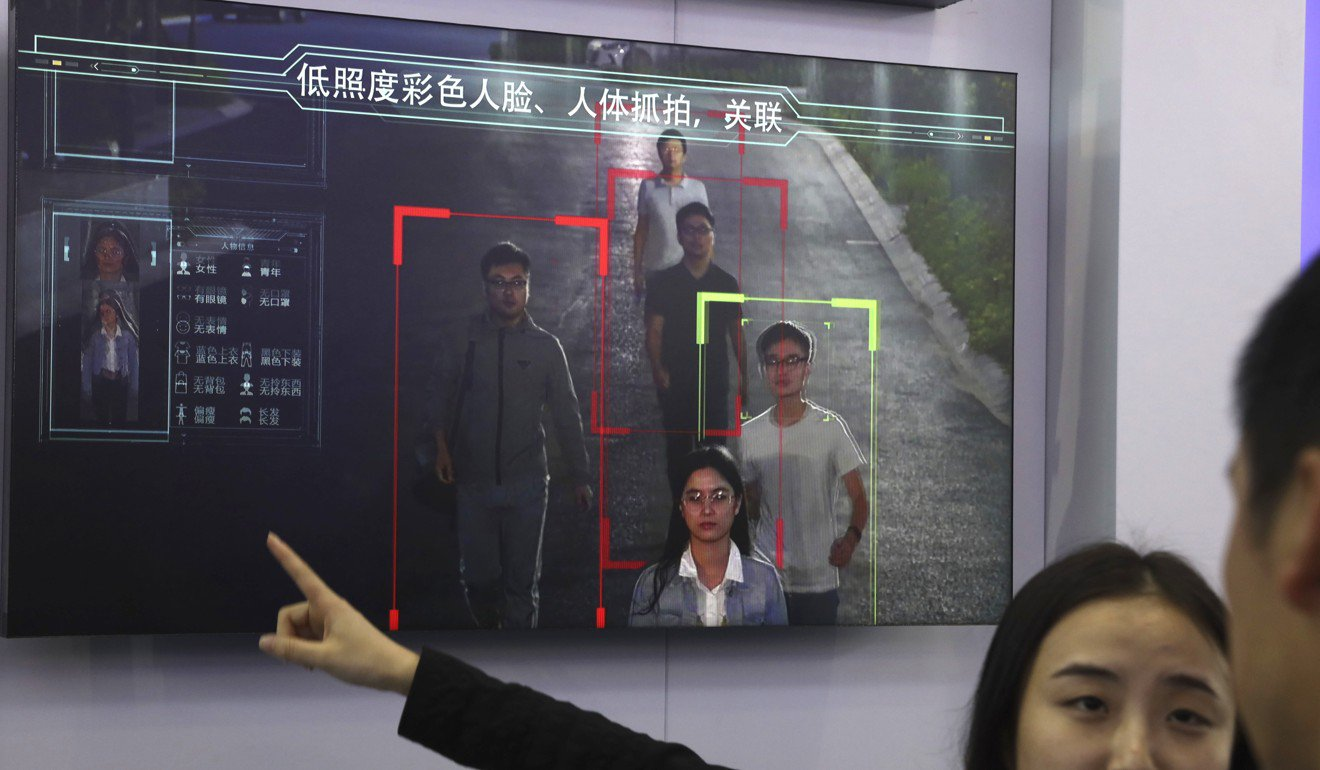 A sales person introduces human identification technology from surveillance equipment manufacturer Hikvision on a monitorin Beijing last year. Photo: AP